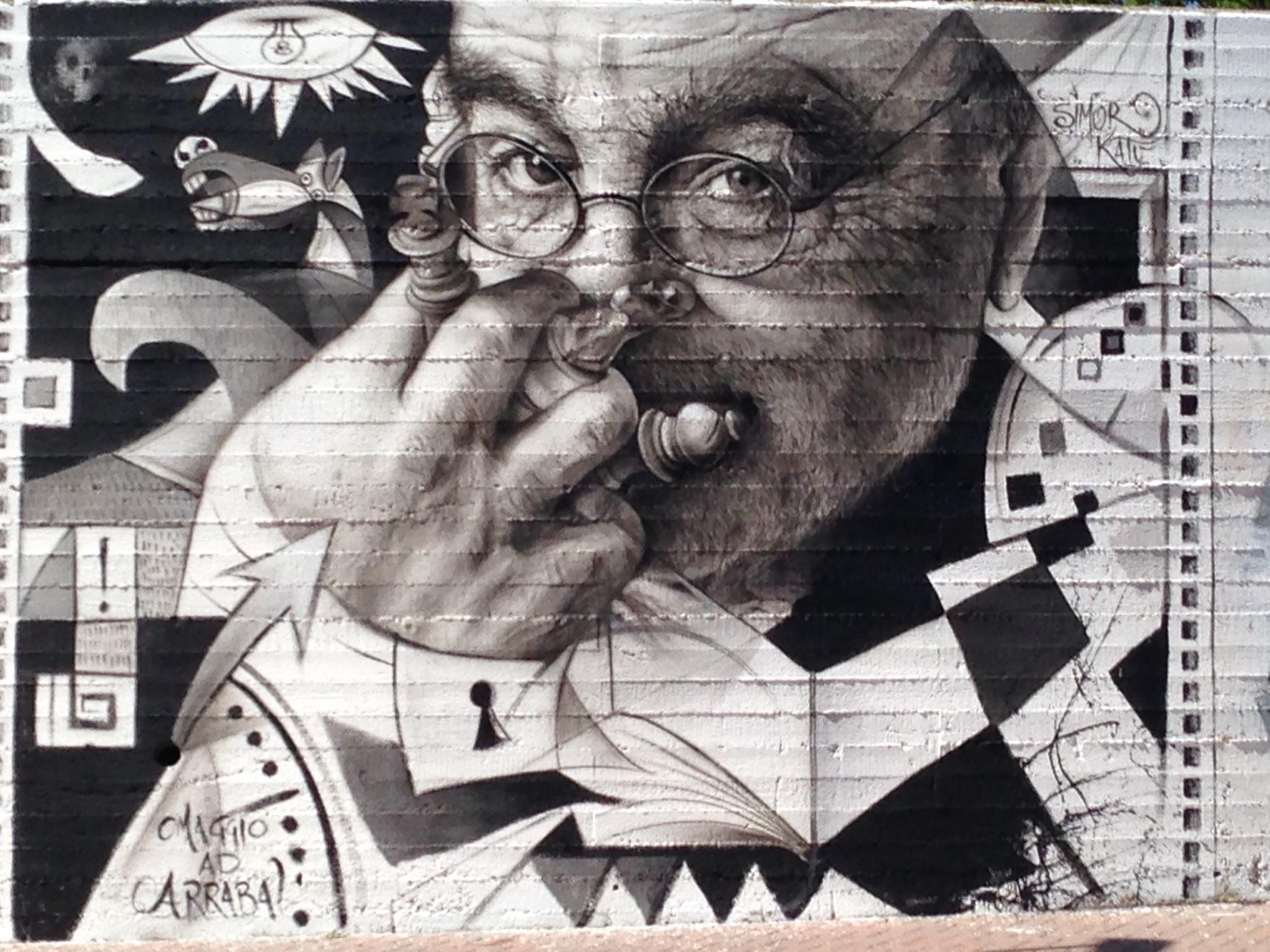 Opera di SImor Katù, ritratto di Fernando Arrabal, progetto di Momart Gallery e Aracnea, via Saragat, Matera